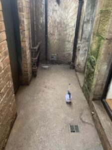 disinfected alleyway after guano has been cleaned up